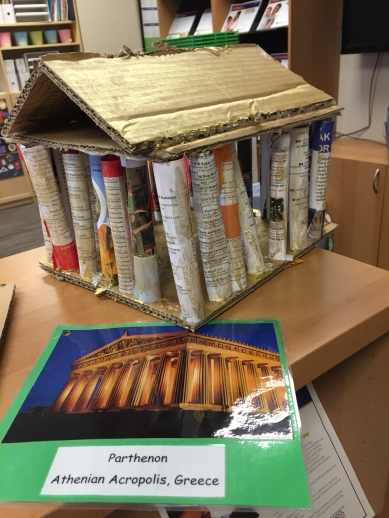 The Parthenon made from cardboard, rolled up magazines and gold liquid watercolor.